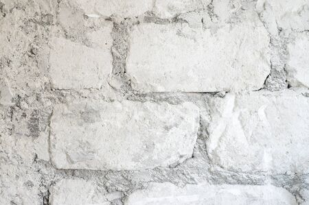 Old limestone wall texture as background.