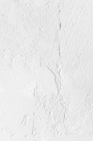 White distressed rough whitewashed wall texture as background. Imagens