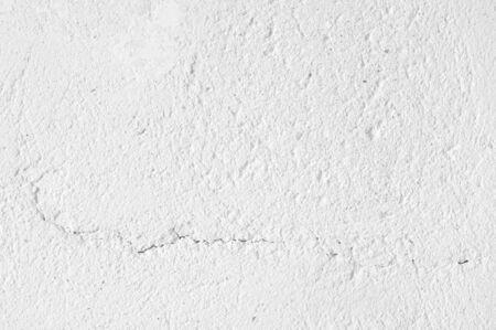 White distressed rough whitewashed wall texture as background. Stockfoto