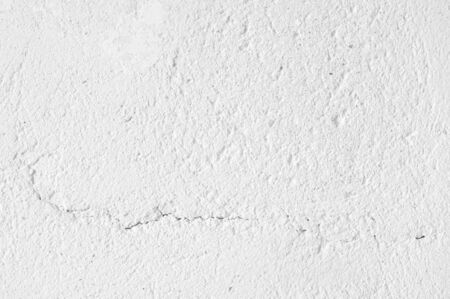 White distressed rough whitewashed wall texture as background. Stock Photo