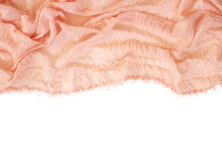 Coral colored crash voile fabric as border on white background.