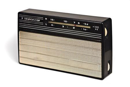 VINTAGE TRANSISTOR RADIO RECEVIER ON WHITE BACKGROUND