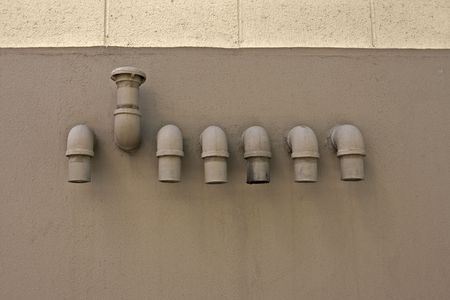 plumbing fixtures on a wall with one opposite direction Imagens