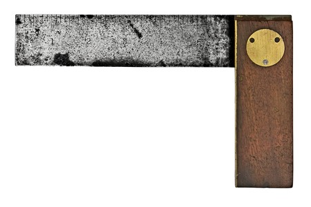 vintage rusty carpenters square isolated over white background photo