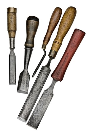 set of vintage chisels isolated over white background