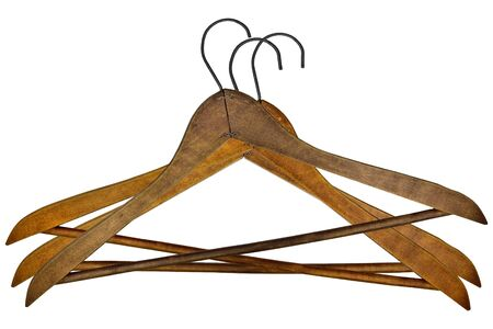 hangers: vintage wooden clothes hangers over white background Stock Photo