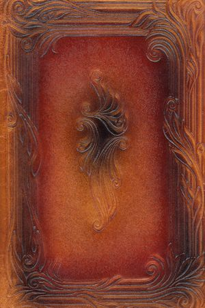 tooled: brown and red leathercraft tooled vintage book cover with texture and border Stock Photo