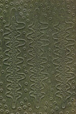 tooled:  green leathercraft tooled vintage book cover with texture and grain