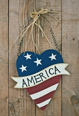 vintage wooden patriotic heart shape decor with word america on the door photo