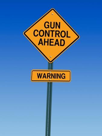 gun control ahead warning roadsign over blue sky Stock Photo