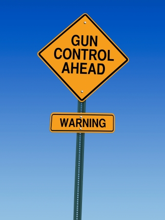 gun control ahead warning roadsign over blue sky Stock Photo
