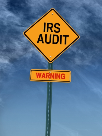 breaking free: warning irs audit conceptual road sign over sky Stock Photo
