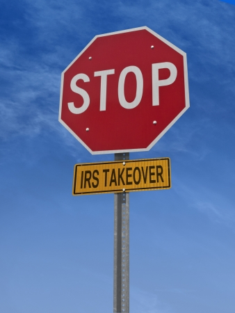 takeover: stop irs takeover conceptual road sign over sky Stock Photo