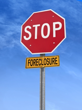 conceptual stop sign with word foreclosure over blue sky Stock Photo