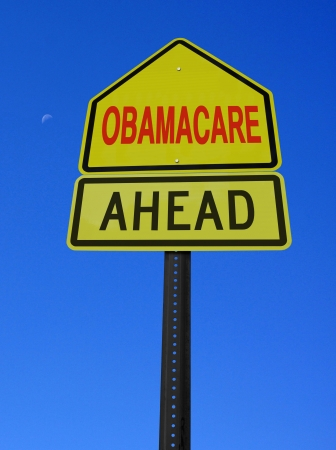 american media: obamacare ahead conceptual directional post over blue sky