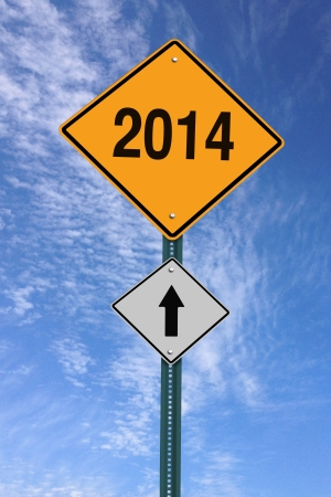 two thousand and fourteen: 2014 ahead road sign over blue sky with clouds