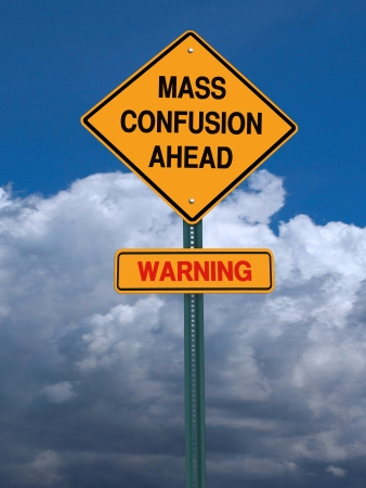 conceptual sign mass confusion ahead and danger warning over blue sky