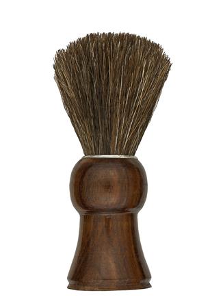 peluquero: brocha de afeitar de la vendimia con mango de madera sobre blanco, camino de recortes