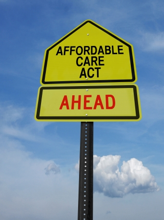 affordable: conceptual sign with words affordable care act ahead over blue sky
