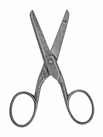 vintage craft household scissors isolated over white background photo