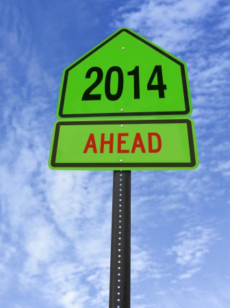 2014 ahead road sign over blue sky with clouds