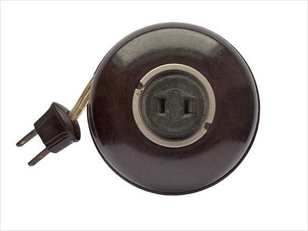 bakelite: vintage brown bakelite extension cord over white Stock Photo