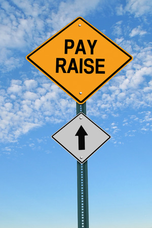 to raise: pay raise ahead road sign over blue sky with clouds