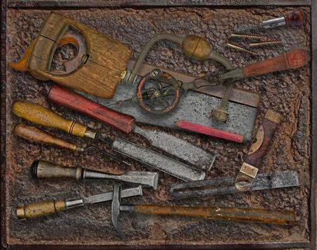 vintage woodworking tools over rusty industrial metal plate 版權商用圖片
