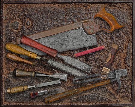 pitted: vintage woodworking tools over rusty industrial metal plate Stock Photo