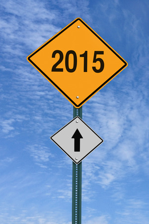 2015 ahead road sign over blue sky with clouds