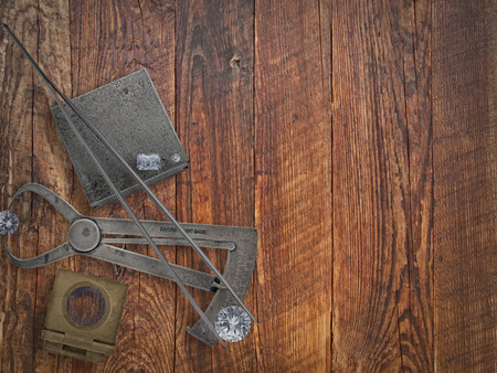 vintage jeweler tools and diamonds over wooden bench, space for text Stock Photo