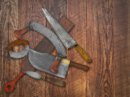 old items: vintage kitchen knives and sharpening tools collage over old wooden table, space for your text