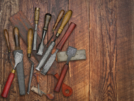 sharpening: set of vintage chisels and sharpening stones, strop over wooden bench, space for your text Stock Photo