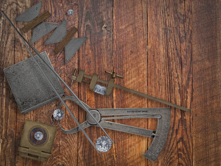 vintage jeweler tools and diamonds over wooden bench, space for text Archivio Fotografico