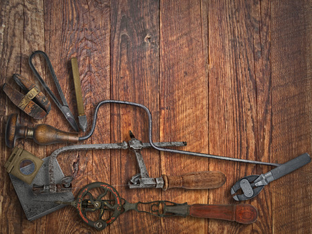 jeweller: vintage jeweler tools  over wooden working bench, space for text