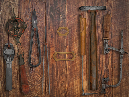 jewelry: vintage jeweler tools  over wooden working wall, space for text and name Stock Photo