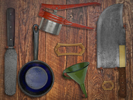 old items: vintage kitchen utensils  over wooden wall, space for text and name Stock Photo