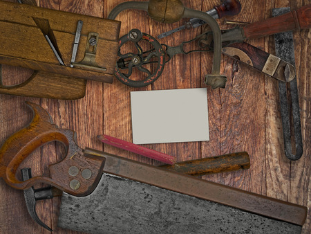vintage woodworking tools on wooden bench, space for your text on a blank business card photo