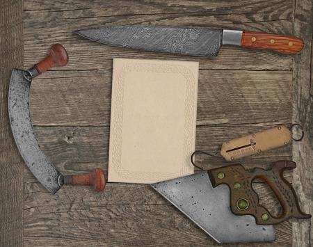 vintage kitchen knives and utensils over wooden board board, blank card for your text Reklamní fotografie
