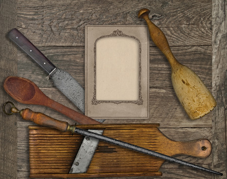 old items: vintage kitchen utensils over wooden board, blank card for your text