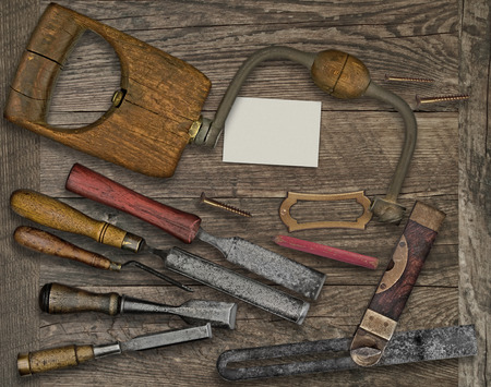 tenon: vintage woodworking  tools over wooden bench, blank plate and business card for your text