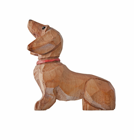 painted dog: vintage dog dachshund wooden painted collar figurine isolated on white, clipping path