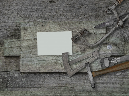 stone cutter: vintage jeweler tools and diamond over wooden bench, blank card for your business