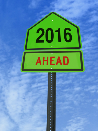 2016 ahead road sign over blue sky with clouds Stock Photo