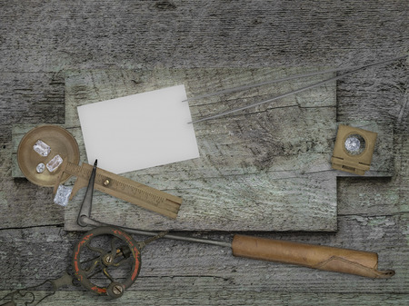 stone cutter: vintage jeweler tools and diamonds over wooden bench, blank card for your business