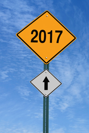 next year: 2017 ahead road sign over blue sky with clouds