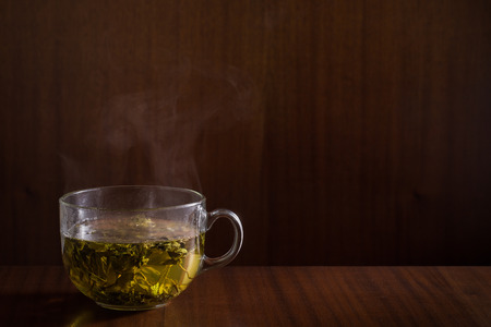 herb tea: Green tea on wood background. Stock Photo