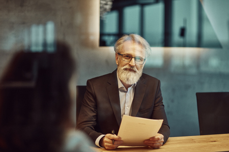 handsome caucasian senior CEO at a meeting. Stock Photo