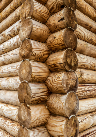 farm building: Corner of old wooden house in the classical style. Stock Photo