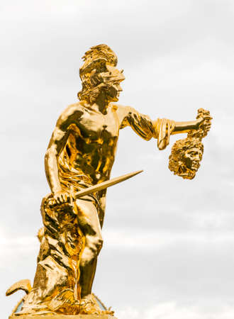peterhof: ST PETERSBURG, RUSSIA - JULY 29, 2015: Palace and Park Ensemble Peterhof. Golden statues and fountains. City Peterhof, Russia. Editorial